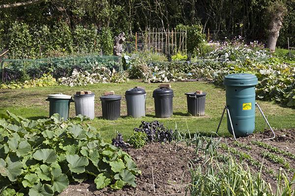 Composting bins in the community kitchen garden at National Trust's Hatchlands Park, Surrey