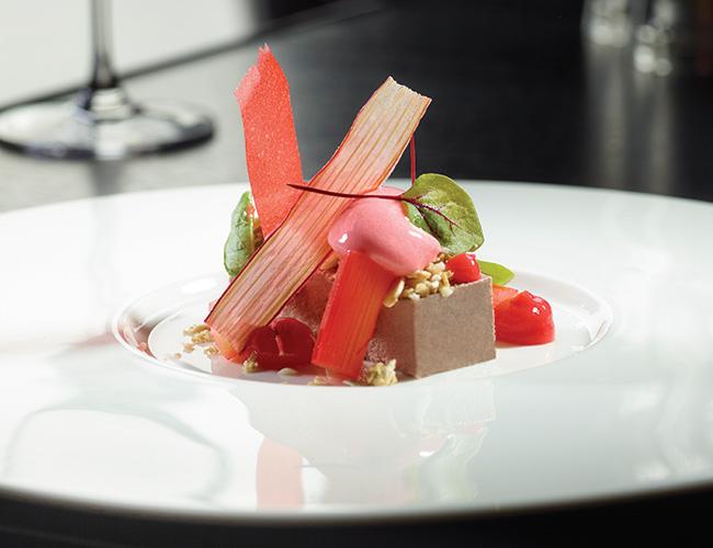 Buttermilk panna cotta, rhubarb sorbet, honeycomb, sorrel by Daniel Moon