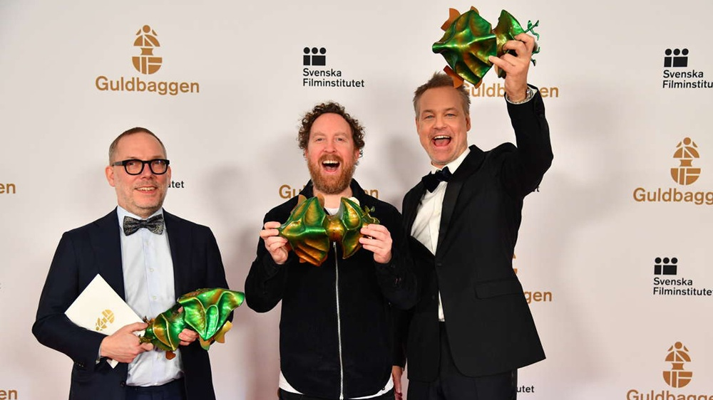 Producer Tomas Michaelsson, actor/screenwriter Uje Brandelius and director Henrik Schyffert picked up three Guldbagge Awards for Run Uje Run. Photo: Pelle T Nilsson /Swedish Press Agency