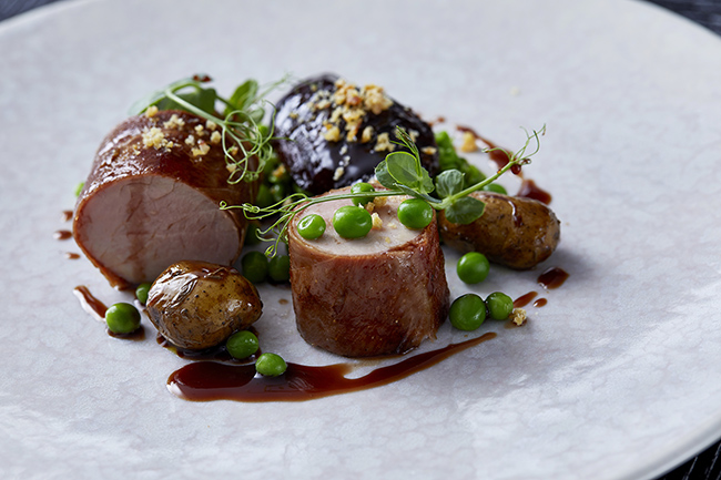 Suffolk pork tenderloin with braised cheek, linzer potatoes and garden peas