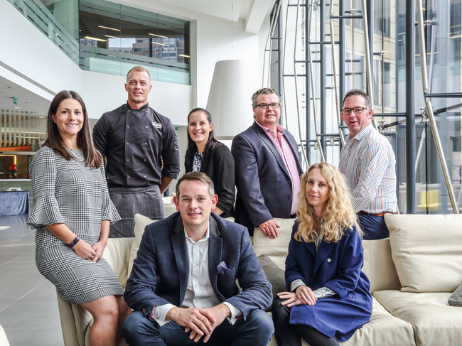 Seated from left: Chris Mitchell and Candy Van Antwerp, head of people. Standing from left: Danielle Mitchell, sales and marketing director; Scott Whiting, development chef; Bee Armstrong, operations manager; Paul Robottom, Signature Dining; and Mark Wetherall, Honest Dining