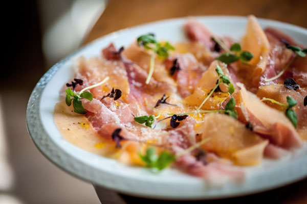 Thinly sliced cured pork loin, Charentais melo, basil and aged parmesan