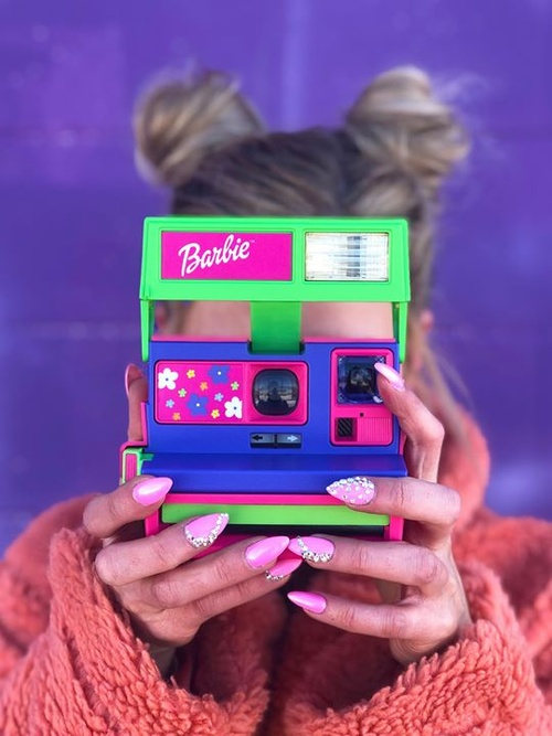 Party like it's 1999 ✨ We're bringing back an icon and a classic with the bold, Barbie-themed Polaroid 600 instant analog camera! Tap to shop. https://www.polaroid.com/products/barbie-throwback-camera
