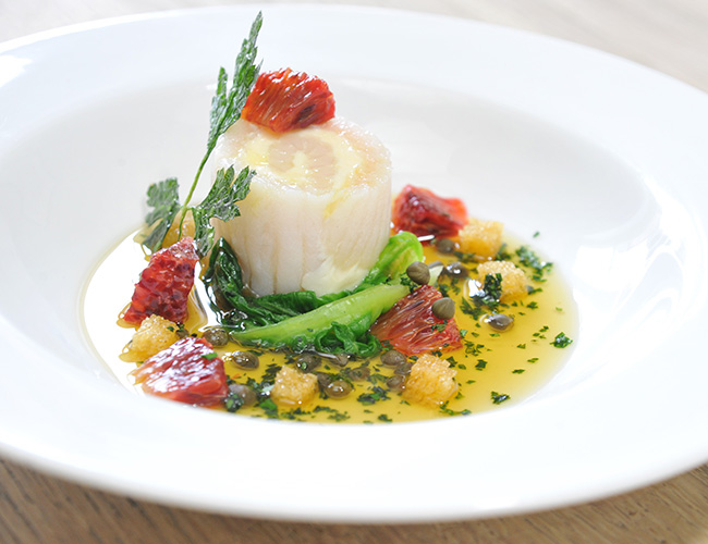 Scallops, stuffed skate wing, blood orange meunière by Stéphane Borie