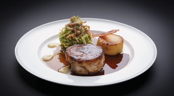 Eight-hour cider-braised pork belly, cider fondant potato, creamed cabbage and bacon, apple purée and cider sauce
