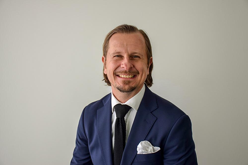 Thomas Anderson, Director of Sales.
