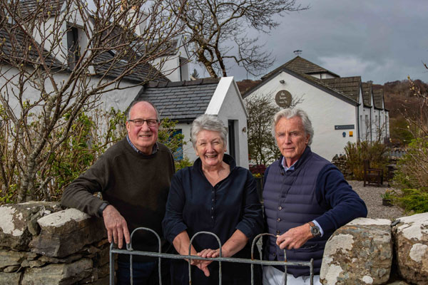 Eddie Spear, Shirley Spear and Gordon Campbell Gray outside The Three Chimneys