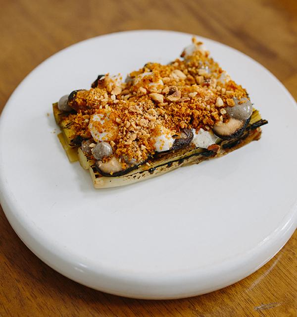 Barbecued leek with truffle, egg yolk,</p><p>shiitake mushroom, feta and hazelnuts