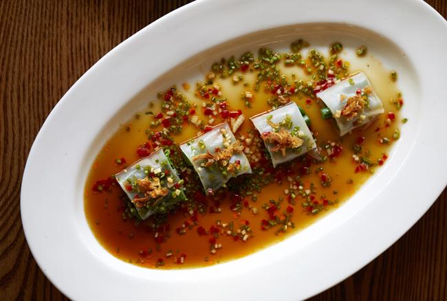 Gai lan cheung fun, a two-part dish incorporating poached yolk