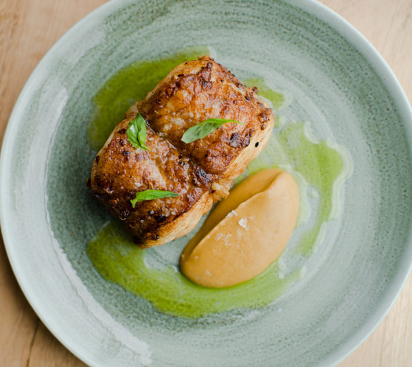 Roast monkfish, spiced aubergine, basil and ginger dressing