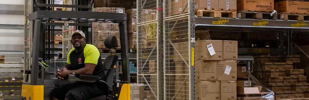 Truck operator in the warehouse of Exertis
