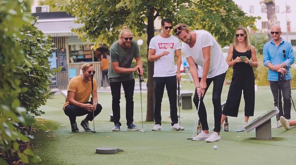 friendly yet competitive game of minigolf at Golfbaren Kristineberg