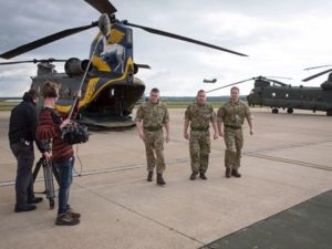 army-chefs-in-uniform-in-front-of-helicopter