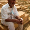 Ghardaya Cemetery, Man Sitting On Grave (Ghardaya, Algeria, 2009)