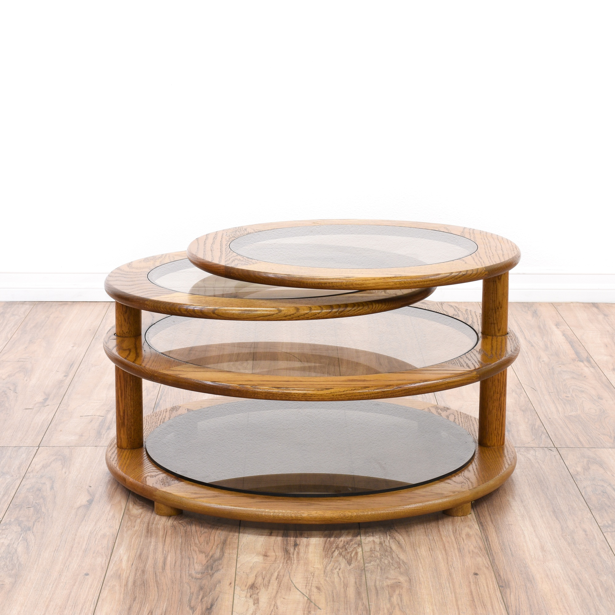 Glass oak round swivel coffee table loveseat vintage for Swivel coffee table