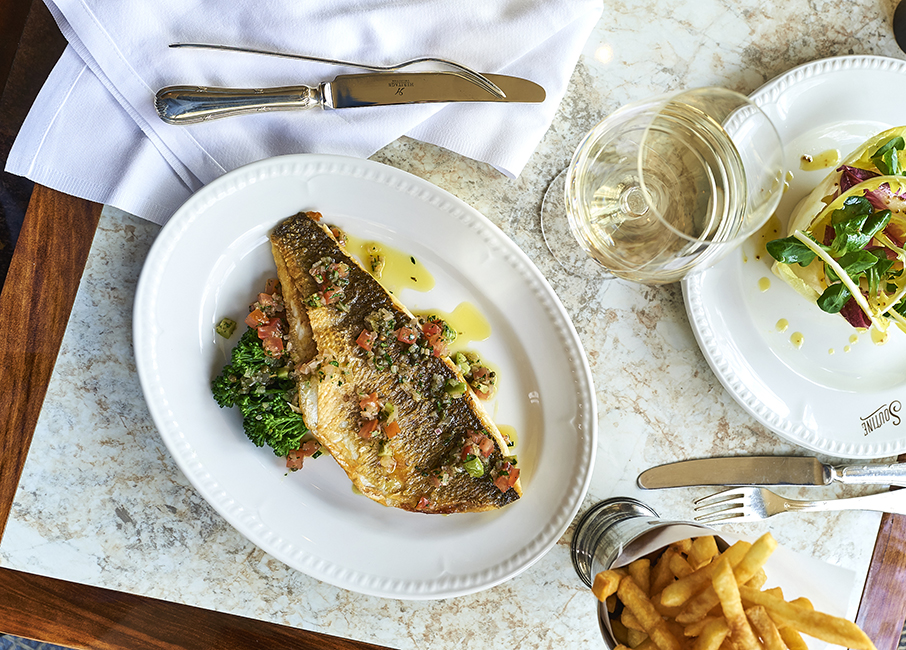 Seared sea bass with Tender stem broccoli and sauce vierge