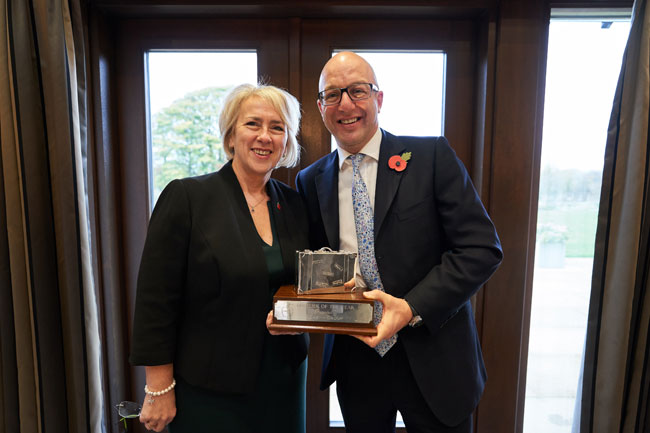 Sue Williams collecting her award from sponsor Nick Appell