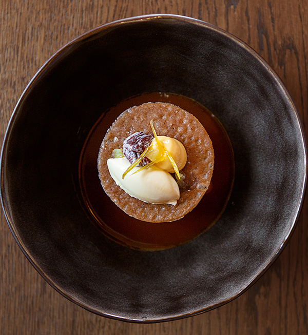Sticky toffee with lemon, clotted cream, walnuts