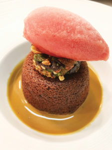 Sticky toffee pudding with candied winter fruits, blood orange and thyme sorbet