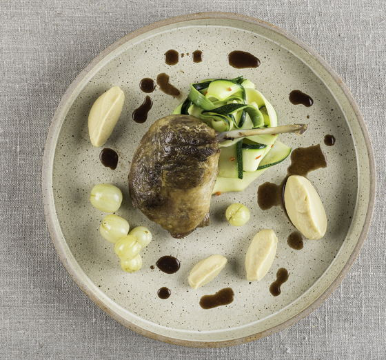 Crispy duck leg with pickled gooseberries and spiced courgettes