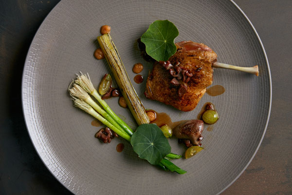 Creedy carver duck leg with charred leek and gooseberry