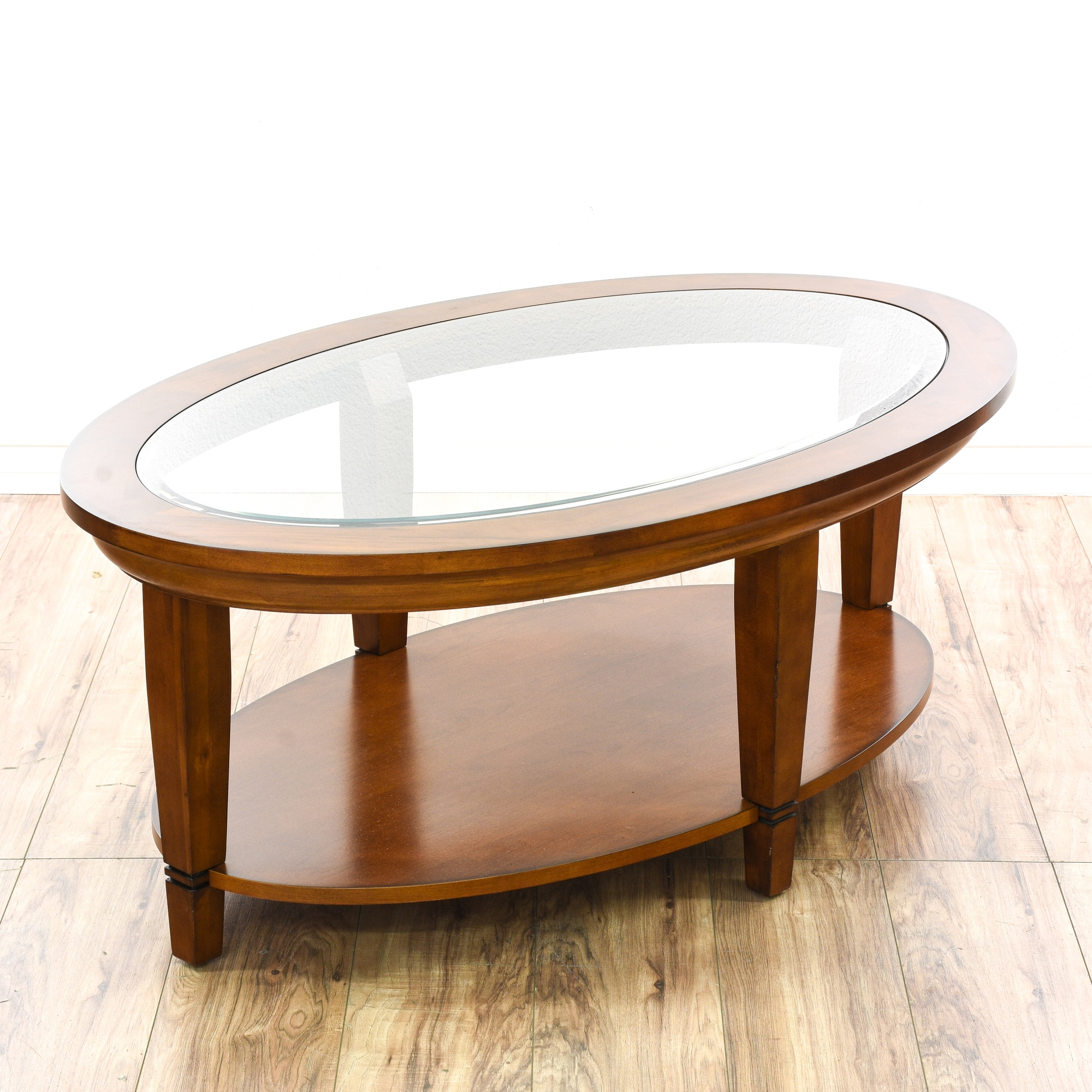 Contemporary tiered oval glass top coffee table loveseat for Contemporary oval coffee tables