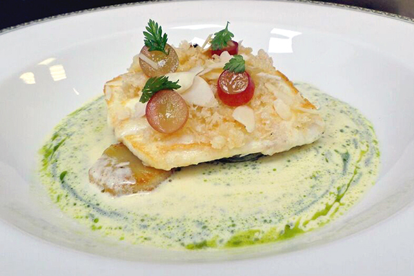 Pan-roast halibut with pickled grapes, almond and confit artichoke