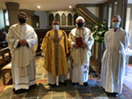 Figure 1 Father David and the masked Clergy Team.jpg