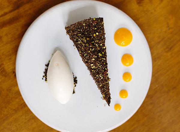 Dark chocolate tart, clementine purée, pistachio and yogurt sorbet
