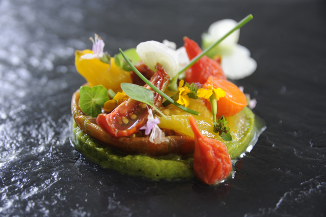 Heritage tomatoes, charred courgette lovage purée, soft herbs and flowers