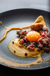 Purbeck lamb tartare, bantam hen's yolk, shoulder croquette, carrot and cumin purée and Dorsetshire sauce pearls