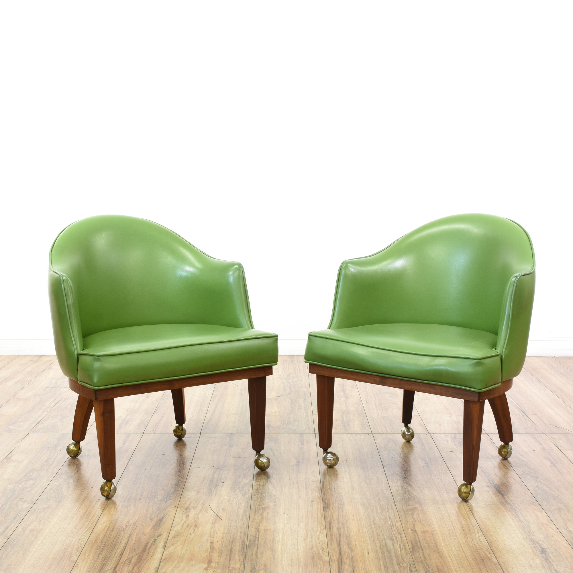 "Pair of ""Chet Beardsley"" Green Vinyl Accent Chairs"