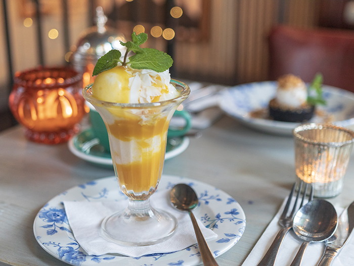 Bill's coconut ice-cream with mango sauce and coconut flakes