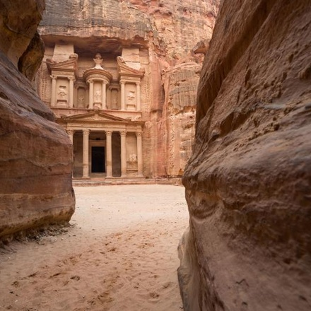 The Treasury appearing at the end of the Siq Canyon - Petra