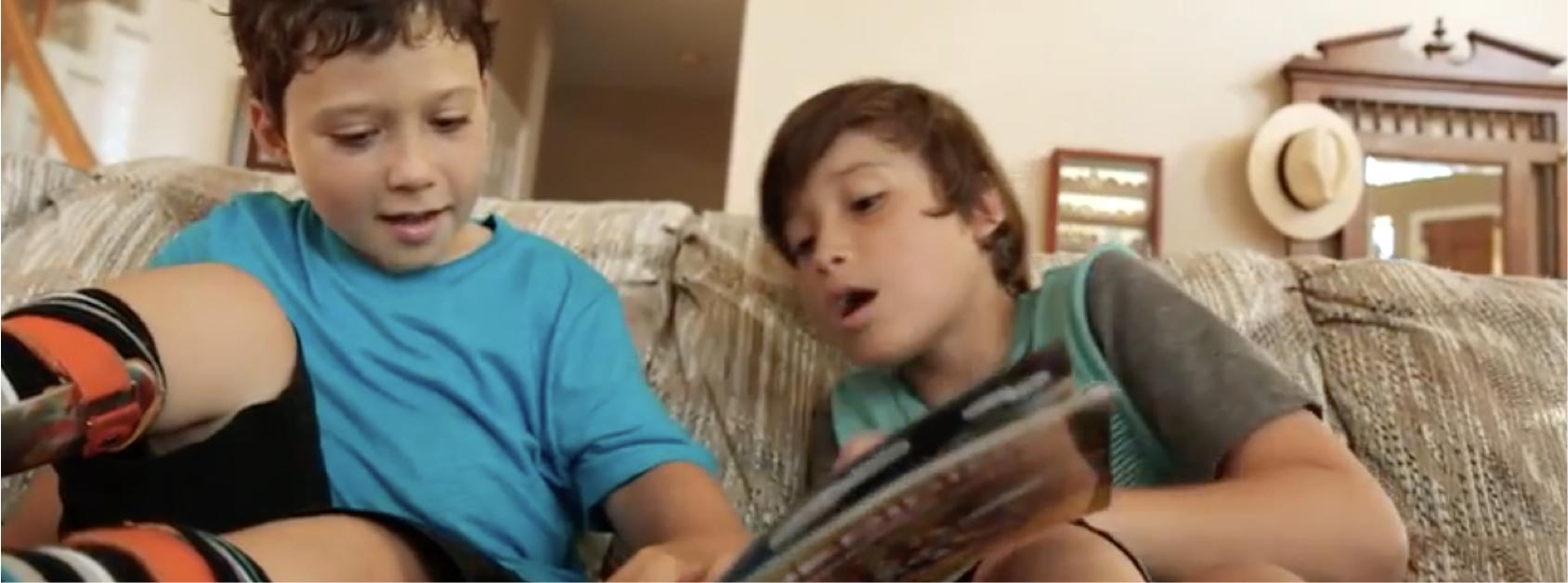 two kids reading comics
