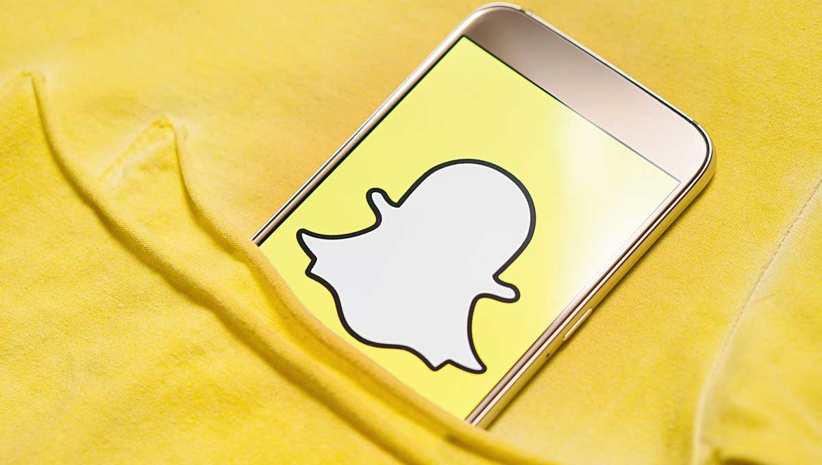A phone showing the Snapchat logo.
