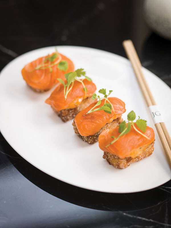 Crispy salmon sushi with chipotle emulsion and soy glaze