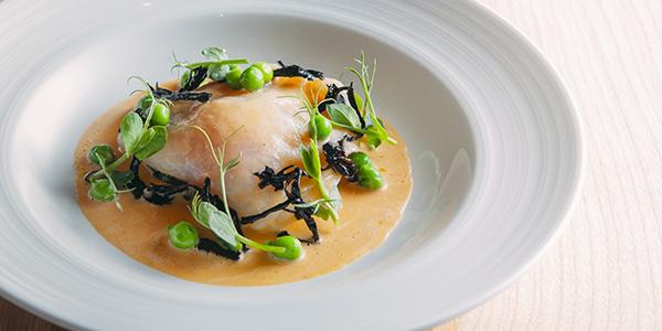 Halibut stuffed with egg yolk, peas, black trumpet mushrooms, sauce mignonette by Hans Haas