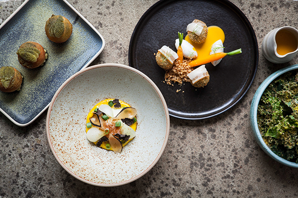 From left: Oldstead onions, duck egg and truffle, and sour pea falafel, pork fat and carrots