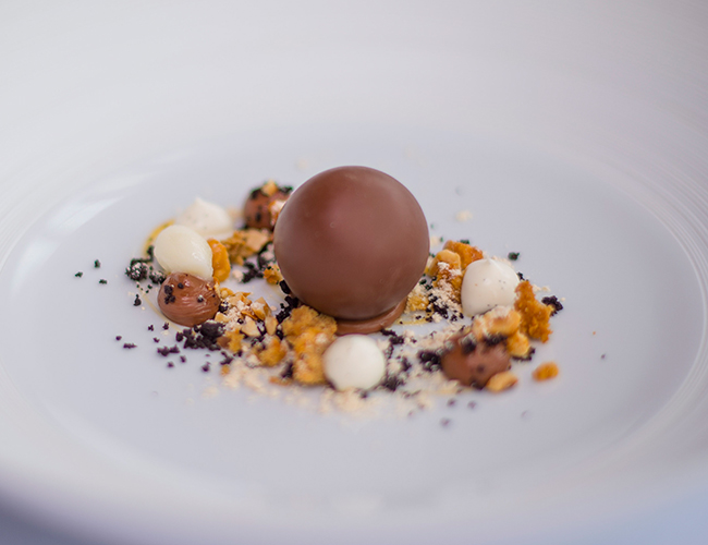 Praline parfait, caramel, bitter chocolate, frozen yoghurt by Michael Wignall at Gidleigh Park