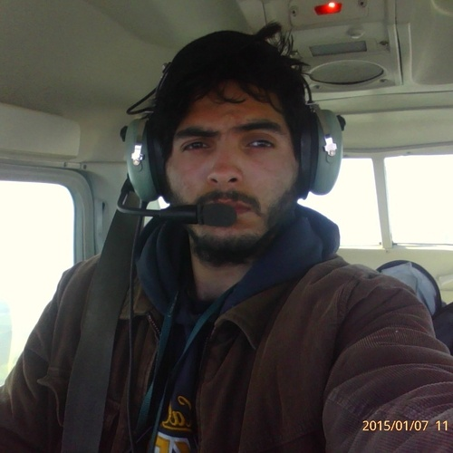 Omar snapping a quick selfie on a solo flight