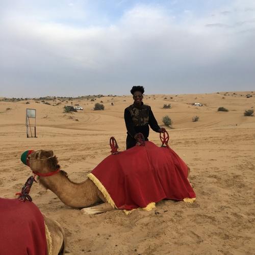 Riding a camel in Dubai.