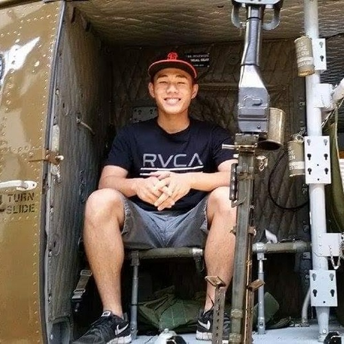 Sitting on a historic relic - a Huey helicopter from the Vietnam War era