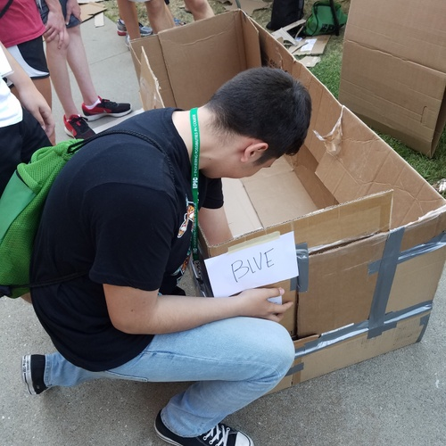 That's me working on a cardboard boat that each group had to build and race.