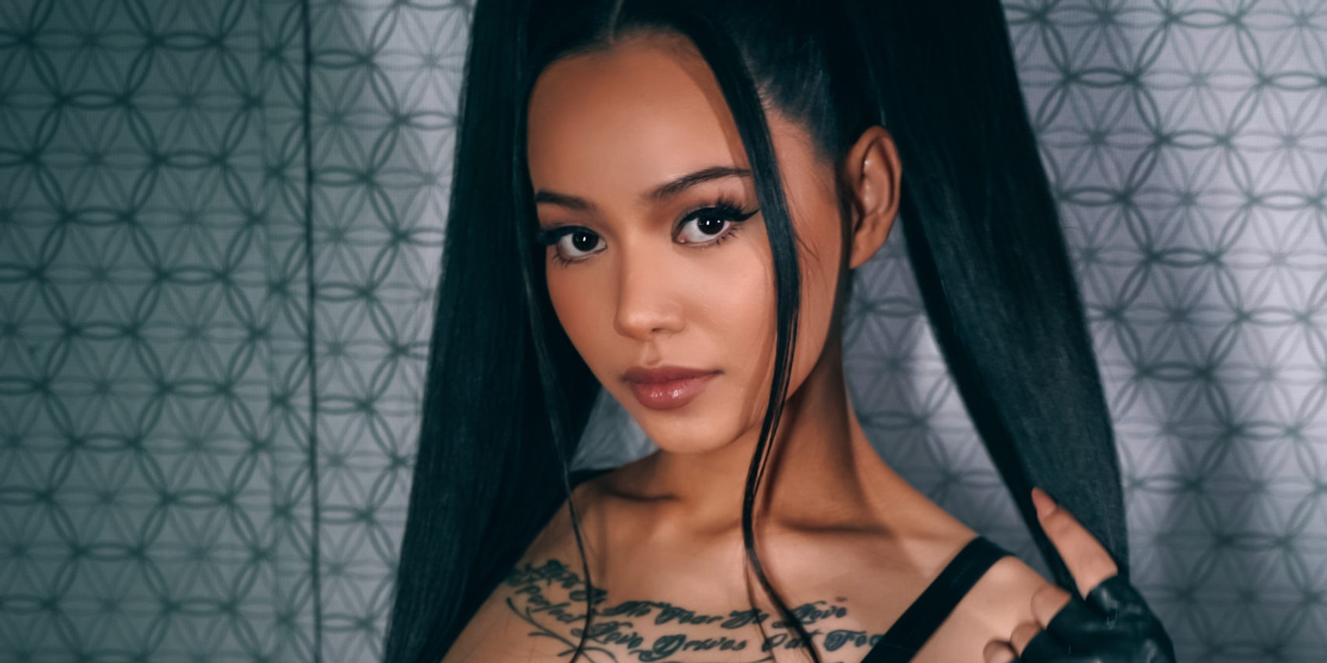 TikTok star Bella Poarch signs to Warner Music, unveils music video for debut single – watch