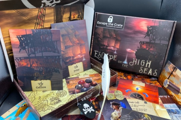 An Escape the Crate subscription box with a pirate related game including ciphers, letters, sleuthing tools, and puzzles