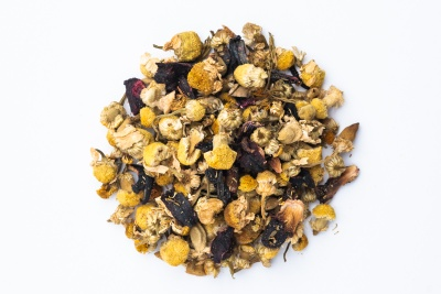 A small pile of dried chamomile flowers that come in a Free Your Tea subscription box.