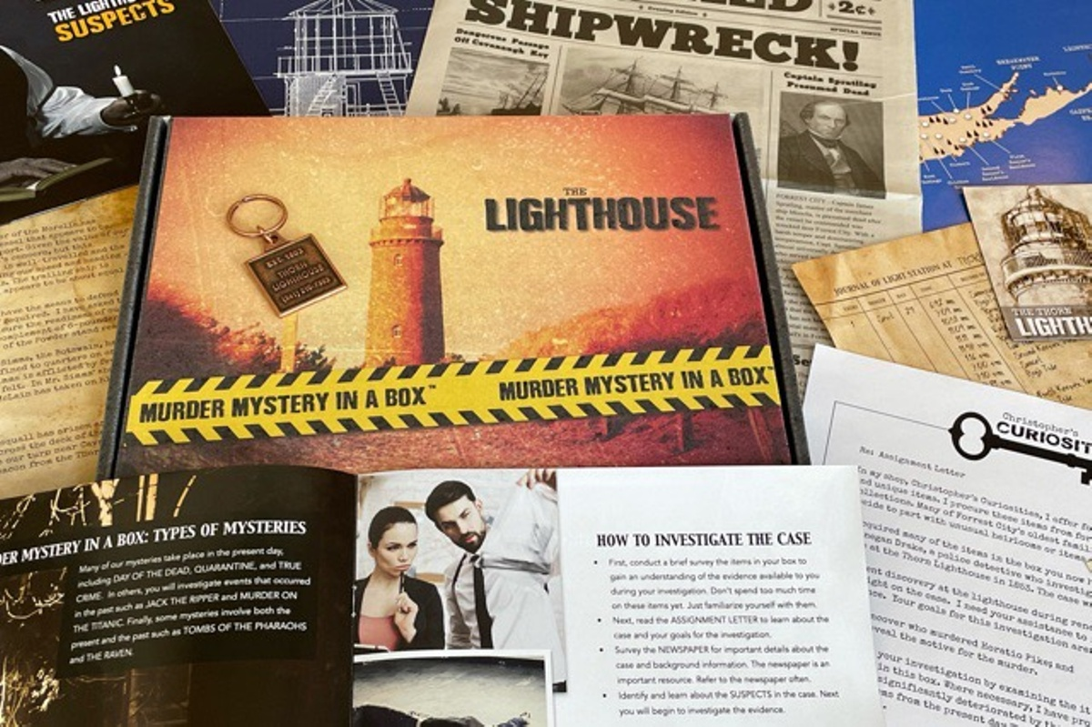 A Murder Mystery in a Box subscription box with an old newspaper, cards showing instructions, suspects and other clues.