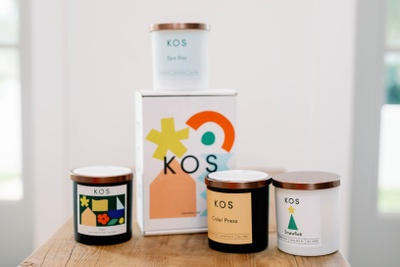 Four jar candles and a box from the Kos Candle Club subscription box.