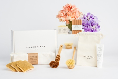 An Essentials Crate subscription box with eco-conscious and sustainable household products like scrub brushes and pads.